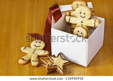 ginger biscuits in a box with a red ribbon - stock photo