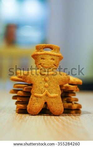 Ginger biscuits in man shape on wooden table - stock photo