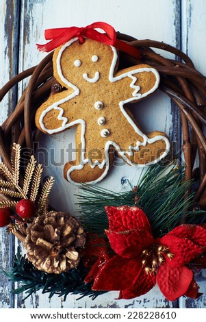 Ginger bread with icing inside Christmas wreath - stock photo