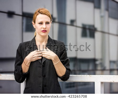 Ginger business woman in front of her working place - stock photo