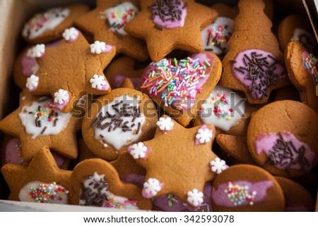 Ginger cookie, biscuit in white box. Homemade sweets. Christmas desert. Decorated with color icing. - stock photo