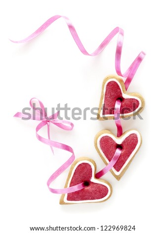 Ginger Heart shaped cookies for Valentine's Day with pink ribbon. Isolated on white background