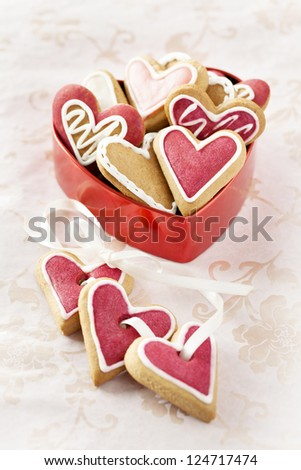 Ginger Heart shaped cookies for Valentine's or Wedding Day in red heart shaped box. - stock photo