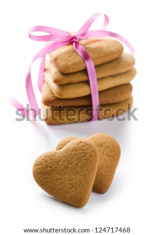 Ginger Heart shaped cookies for Valentine's or Wedding Day with pink ribbon. Isolated on white background - stock photo