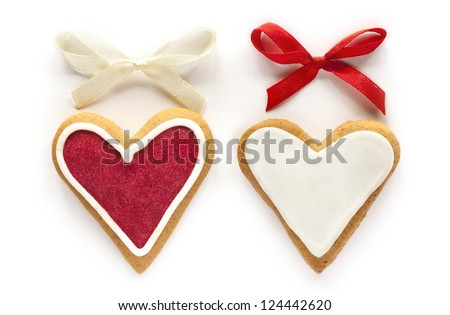Ginger Heart shaped cookies for Valentine's or Wedding Day with red and white bow. Isolated on white background - stock photo