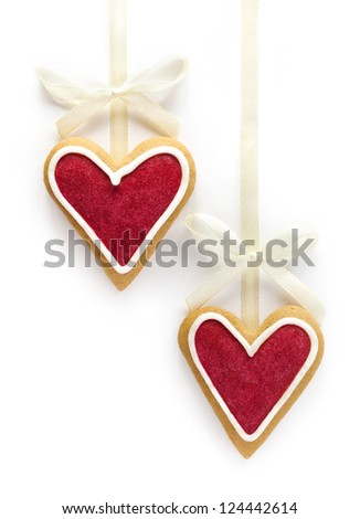 Ginger Heart shaped cookies for Valentine's or Wedding Day with white bow and ribbon. Isolated on white background - stock photo