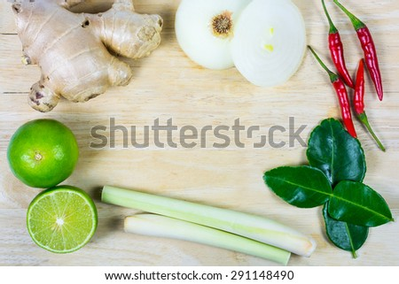 ginger, lemograss, onion, lime leaves, chilli, lemon, Fresh herbs and spices asian ingredients food on wood bac kground , thai food. - stock photo