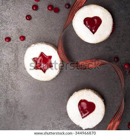 Ginger-lemon cookies with cranberry jam, sprinkle with powdered sugar ...
