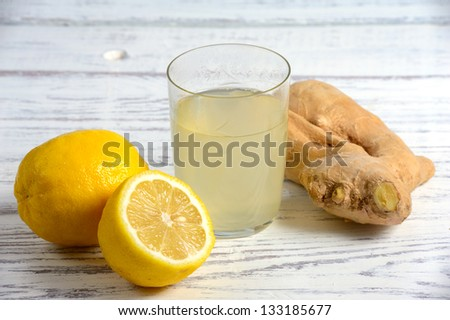Ginger, lemon, glass on the table