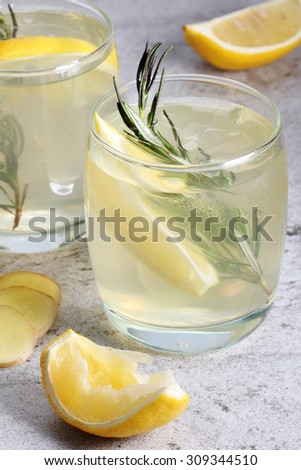 Ginger Lemonade drinks garnish with rosemary in a glass