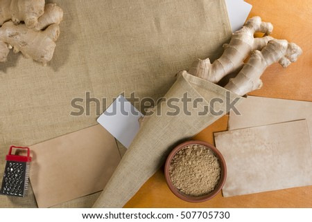 Ginger root and powder on a linen napkin