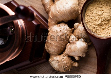 Ginger root and spice closeup on wooden table - stock photo