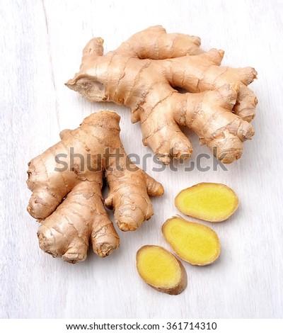 Ginger root. Slices ginger on white background. - stock photo