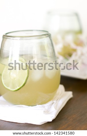 Ginger soda with lime, ginger ale, and agave syrup. - stock photo