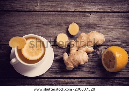Ginger tea with lemon in a white cup - stock photo
