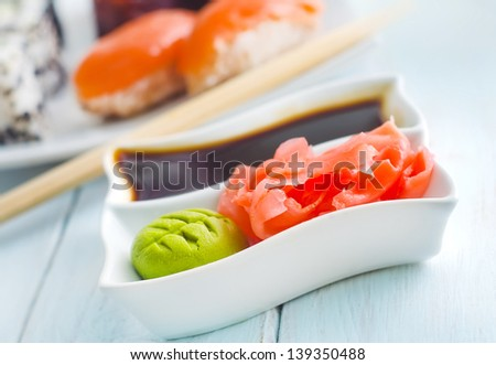 ginger, vasabi and soy sauce in white bowl - stock photo