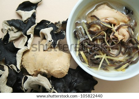 Ginger wine chicken with wood ear fungus, a dish traditionally prepared for mothers during confinement period after birth - stock photo