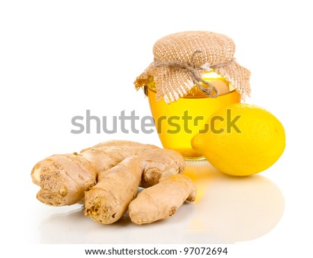 Ginger with lemon and honey isolated on white - stock photo