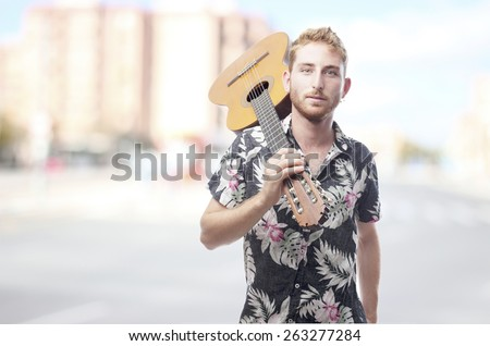 ginger young man with hawaiian shirt . - stock photo
