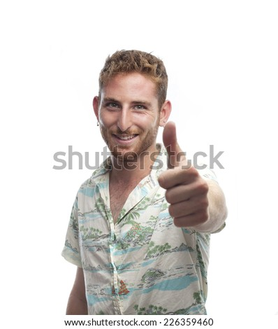 ginger young man with hawaiian shirt all right gesture - stock photo