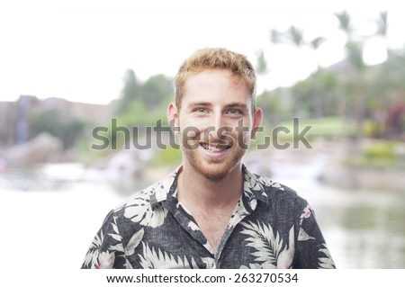 ginger young man with hawaiian shirt happiness - stock photo
