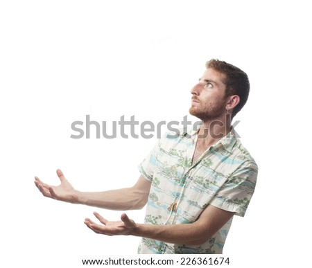 ginger young man with hawaiian shirt  holding something - stock photo