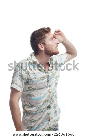 ginger young man with hawaiian shirt looking away