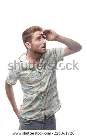 ginger young man with hawaiian shirtginger young man with hawaiian shirt looking far - stock photo