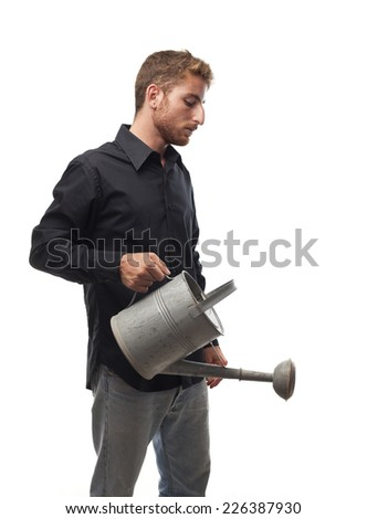 ginger young man with shirt with a watering can - stock photo