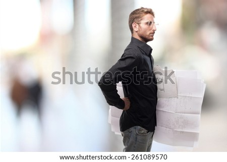 ginger young man with shirt with project - stock photo