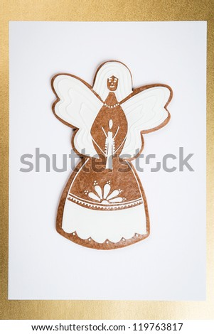 gingerbread angel on white background in golden frame