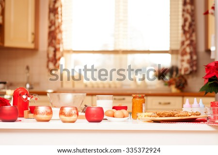 Gingerbread baking in bright kitchen. Christmas time. - stock photo