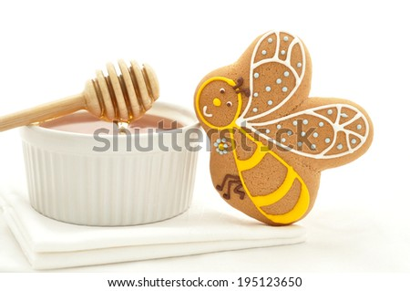 Gingerbread bee cookie and honey jar - stock photo