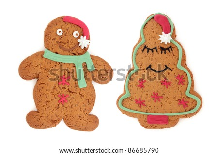 Gingerbread biscuit people of male and female characters isolated over white background.