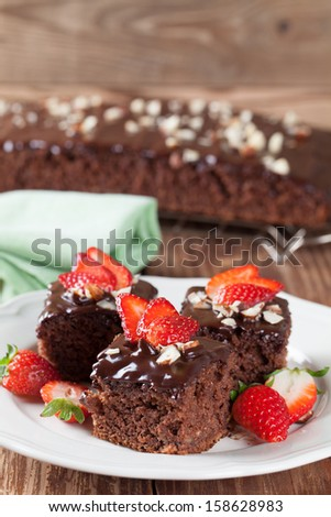 Gingerbread cake with chocolate, strawberries and hazelnuts. Shallow dof