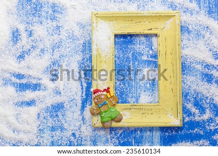 Gingerbread Christmas card.  Christmas card with gingerbread and yellow frame. Cooking concept. Copy space for your text. - stock photo