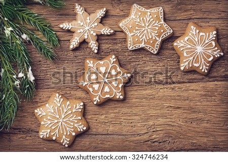 Gingerbread christmas cookies on a wooden brown background - stock photo