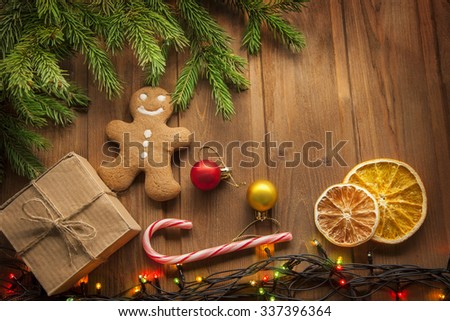 gingerbread Christmas tree and gifts on wooden table - stock photo