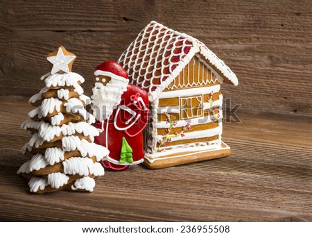 Gingerbread Christmas tree, Santa and decorated house - stock photo