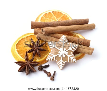 Gingerbread cookie and spices for Christmas baking on white background. - stock photo