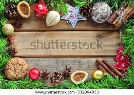 Gingerbread cookie and spices over wooden background