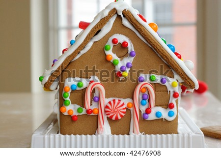 Gingerbread cookie house dotted with colorful candy