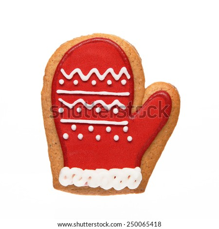Gingerbread cookie in mitten shape isolated on white background - stock photo