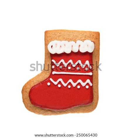 Gingerbread cookie in sock shape isolated on white background - stock photo