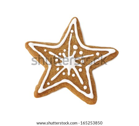 Gingerbread cookie in the form of a star, decorated for Christmas with icing                  - stock photo