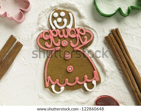 Gingerbread cookie lying on flour with molders - stock photo