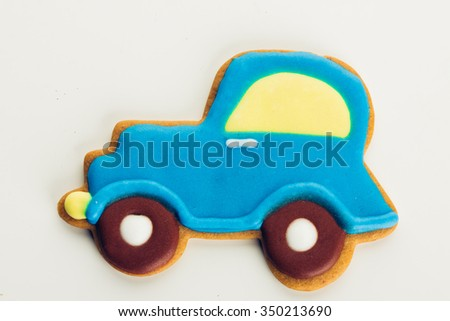 Gingerbread cookie on a white background (car) - stock photo