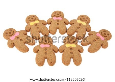 Gingerbread cookie selection with pink and yellow bow ties over white background.