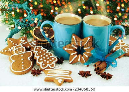 Gingerbread cookies and cups of cocoa. - stock photo
