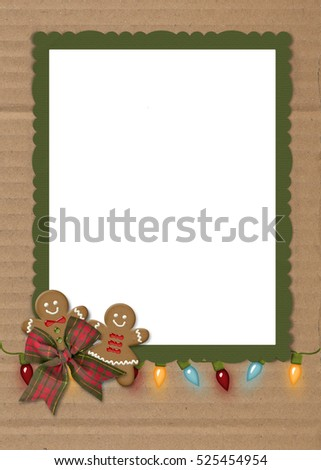 gingerbread cookies and glowing light string on green frame with cardboard background